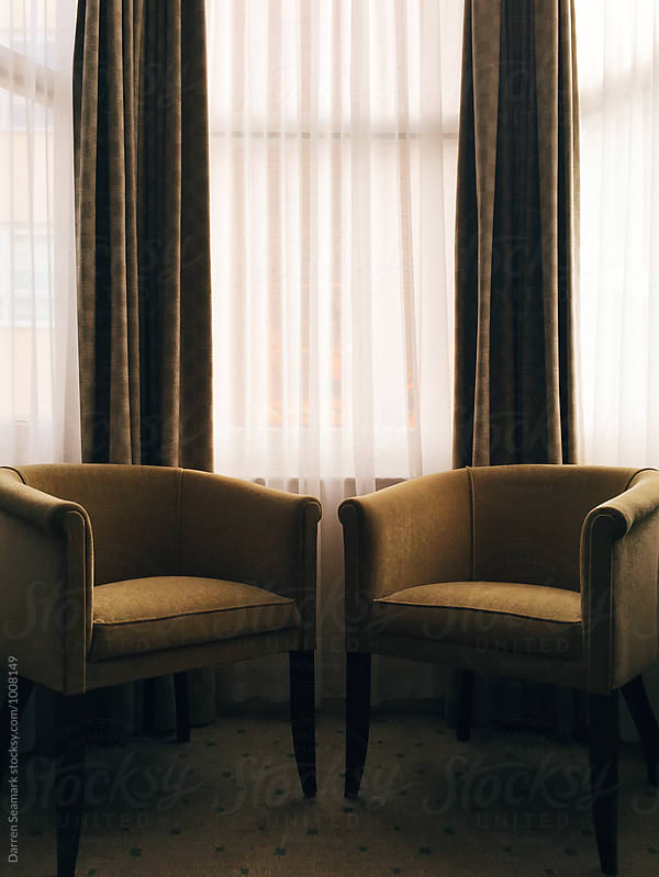 Two chairs and a bay window by Darren Seamark for Stocksy United