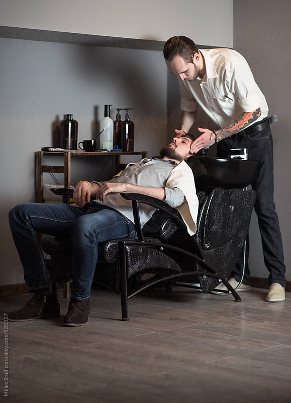Barber Washing Hair to a Client by Milles Studio for Stocksy United