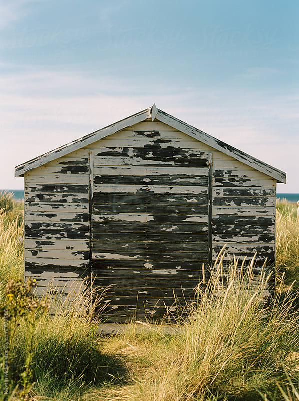 Weathered beach hut, Norfolk by Kirstin Mckee for Stocksy United