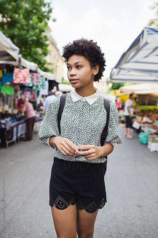 Girl walking down the local market by michela ravasio for Stocksy United