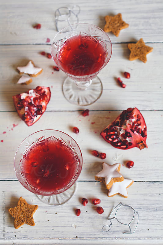 Champagne and pomegranate cocktail by Pixel Stories for Stocksy United