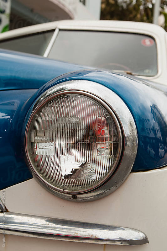 Headlight on a classic car by Stephen Morris for Stocksy United