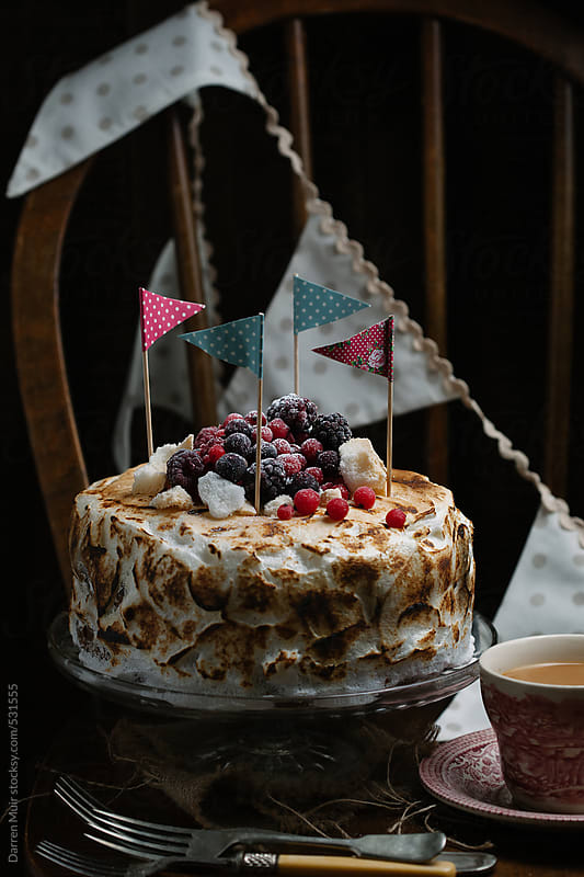 Homemade Italian meringue cake with summer fruits. by Darren Muir for Stocksy United