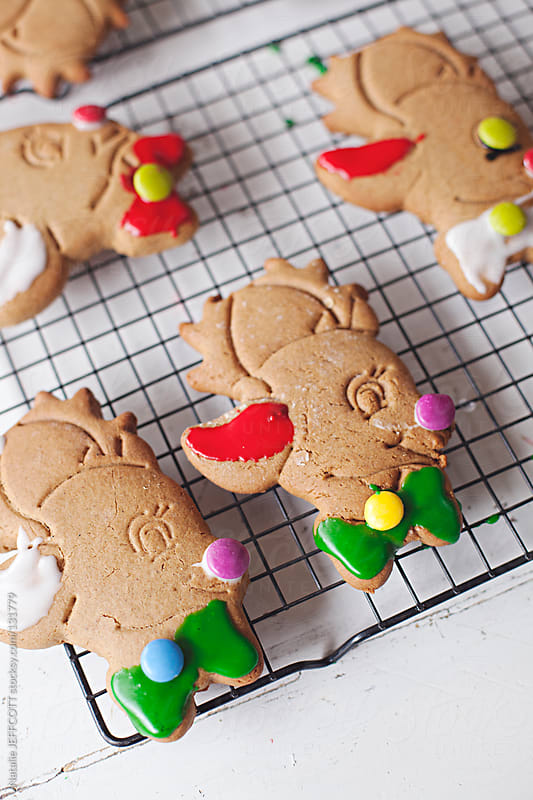 close up of reindeer gingerbread biscuits for Christmas by Natalie JEFFCOTT for Stocksy United