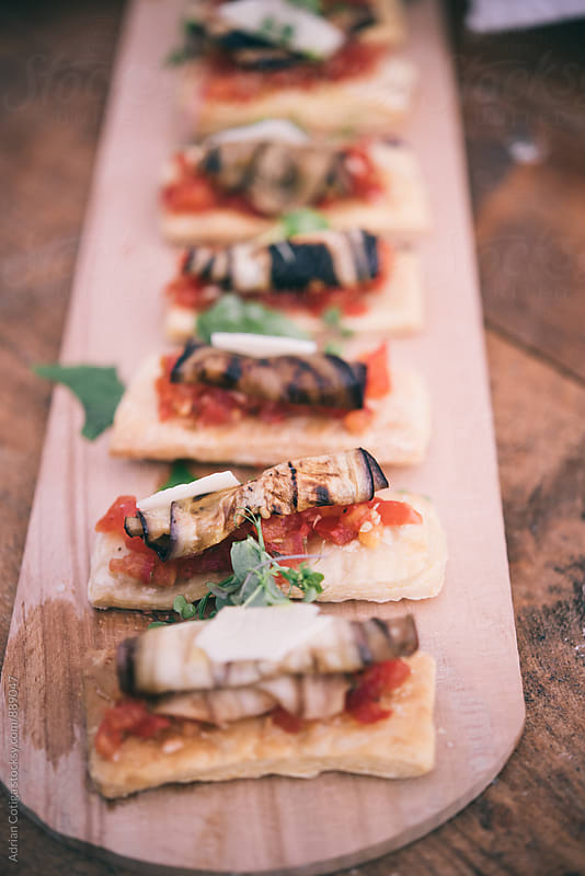 Bruschetta with grilled eggplant by Adrian Cotiga for Stocksy United