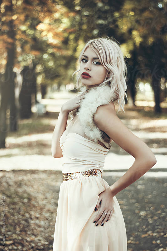 Girl posing in the park by Jovana Rikalo for Stocksy United