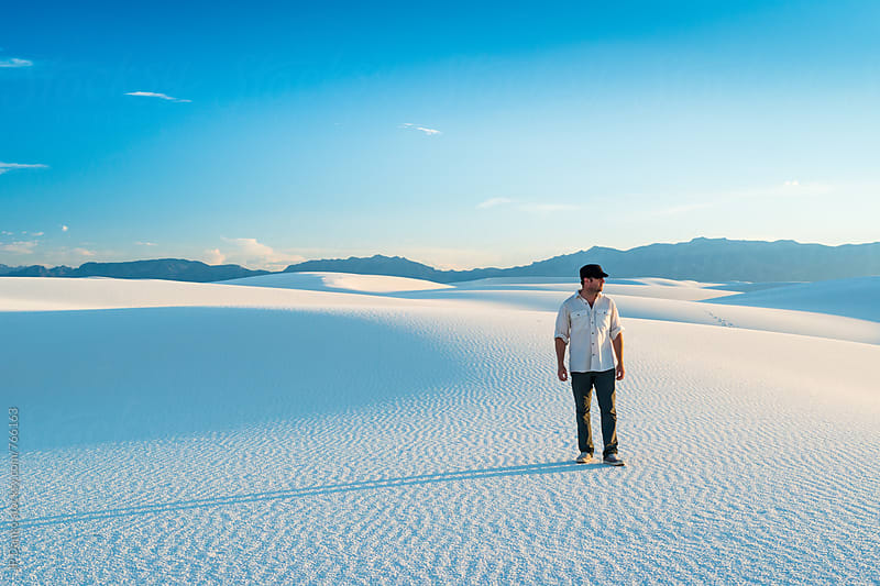 Man Hiking In White Sand Dunes with Vibrant Clear Blue Sky in White Sands National Monument New Mexico by JP Danko for Stocksy United