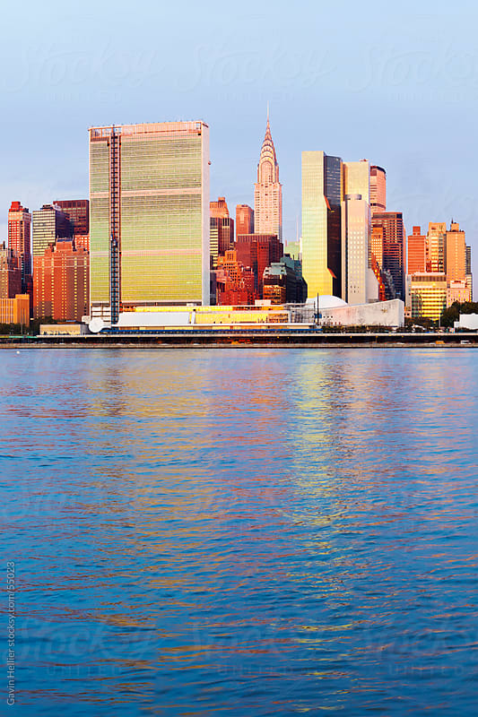 Skyline of Midtown Manhattan seen from the East River showing the Chrysler Building and the United N by Gavin Hellier for Stocksy United