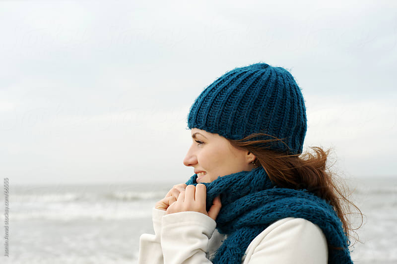 Young woman at the beach in winter series by Jasmin Awad for Stocksy United