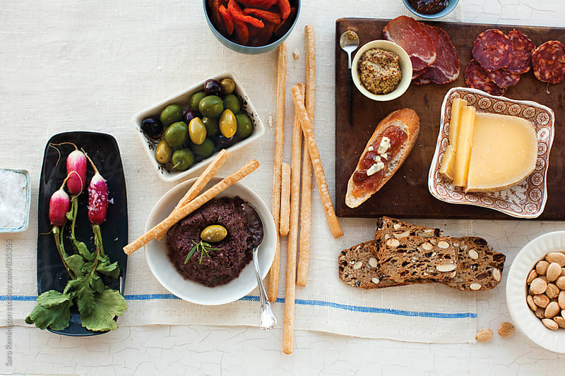 Appetizers, Olives, and Cheese Plate by Sara Remington for Stocksy United