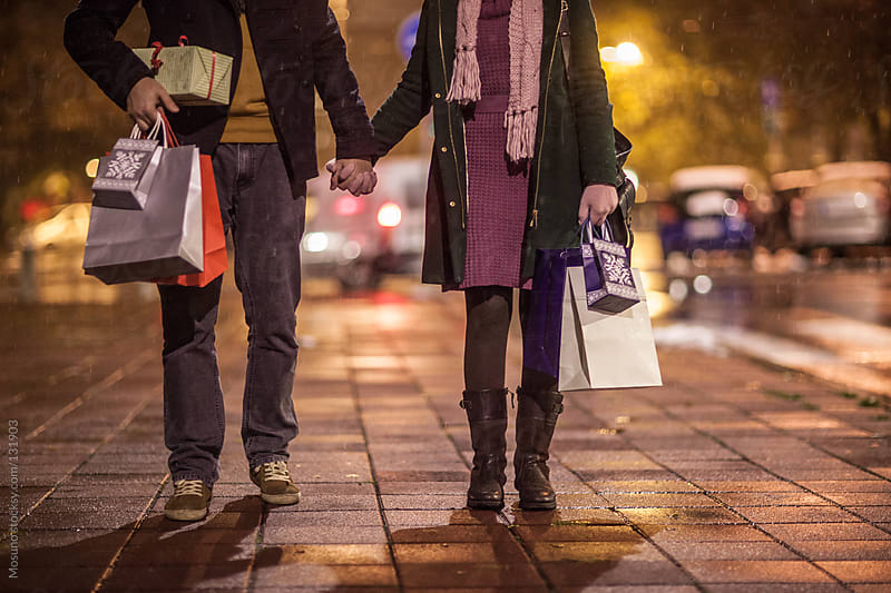 Couple Walking With Bags and Christmas Gifts by Mosuno for Stocksy United