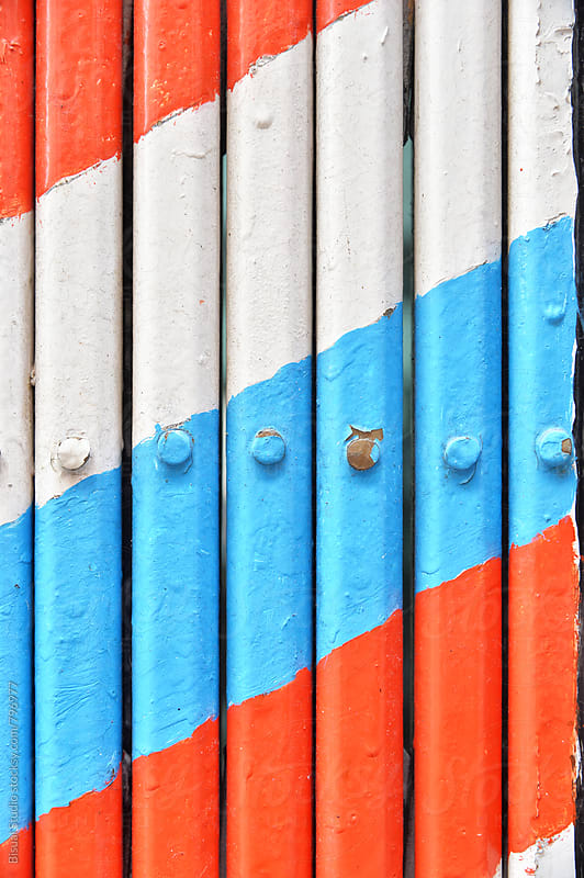 Barber stripes on a fence by Bisual Studio for Stocksy United