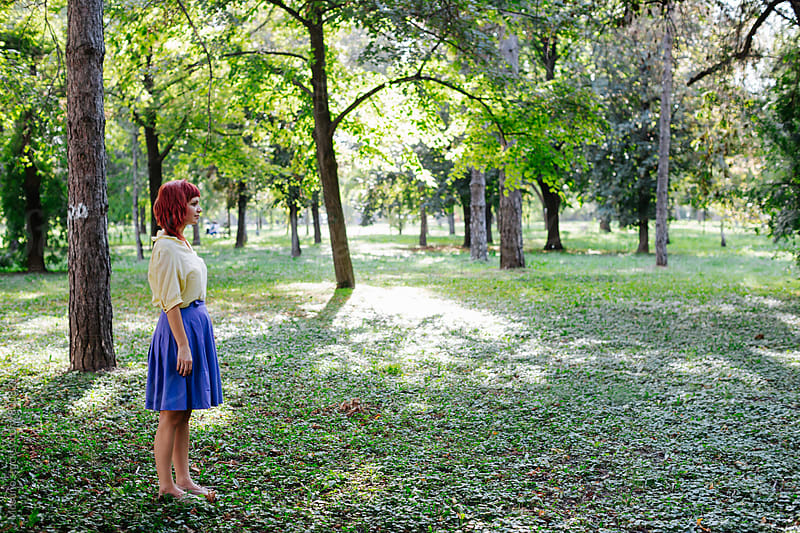 Redhead Woman Standing in the Park by Mosuno for Stocksy United