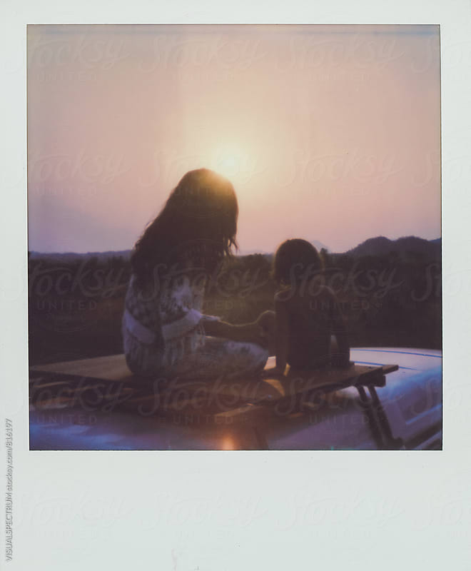 Polaroid of Mother and Child Sitting on Camper Van Roof at Sunset by Julien L. Balmer for Stocksy United