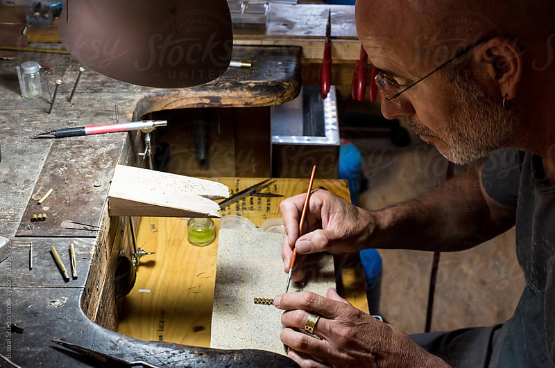 Jeweler making a necklace on his wokshop by Bisual Studio for Stocksy United