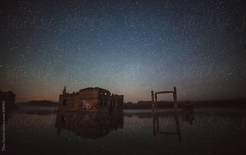 Old buildings in a lake by Tõnu Tunnel for Stocksy United