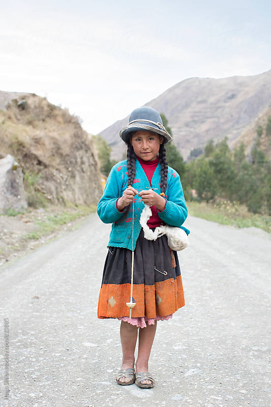Young traditionally dressed girl, knitting wool. Peru by Hugh Sitton for Stocksy United