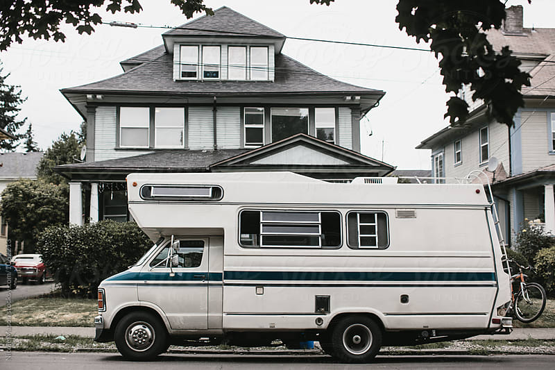 camper van parked outside of house in the street by Nicole Mason for Stocksy United