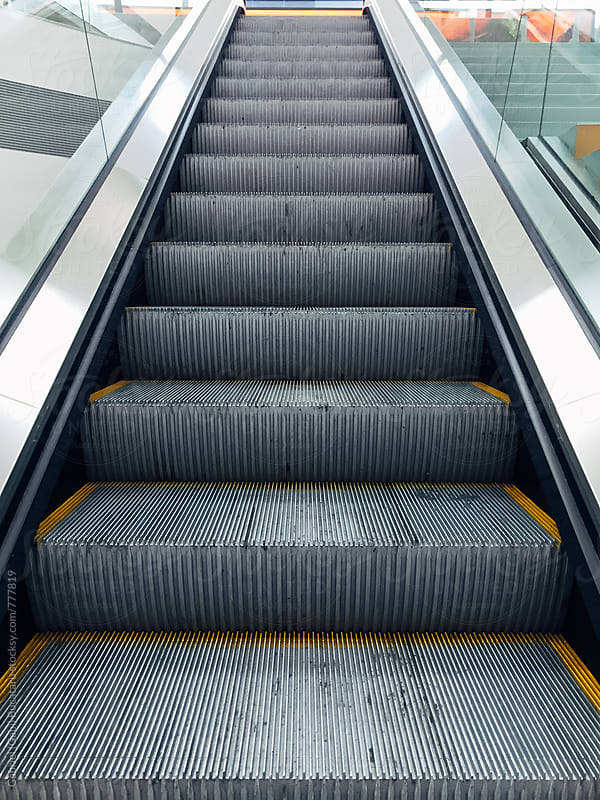 Escalator steps by Gabriel (Gabi) Bucataru for Stocksy United