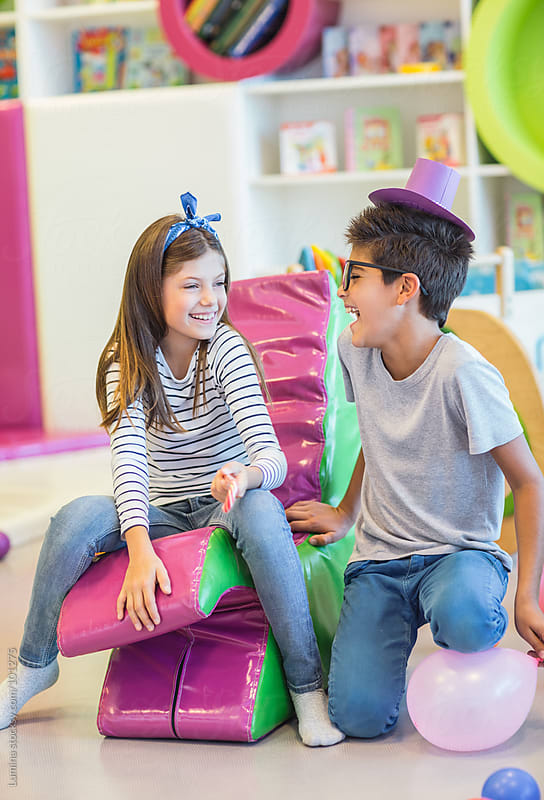 Kids Having Fun in the Playroom by Lumina for Stocksy United