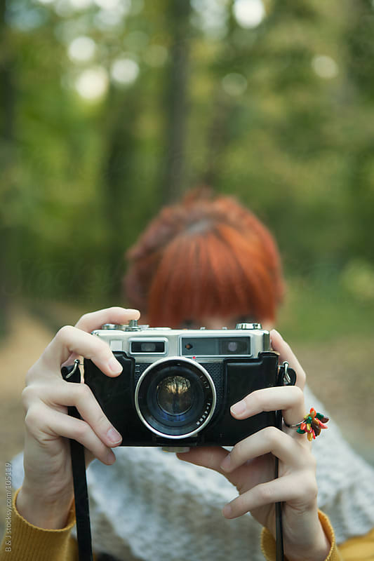 ginger with a retro camera by B & J for Stocksy United