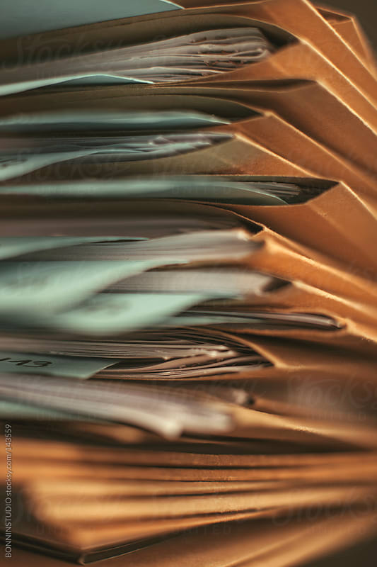 Stack of documents folders on office. Selective focus. by BONNINSTUDIO for Stocksy United
