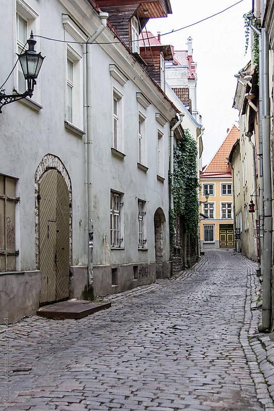 Narrow street in the old town of Tallinn by Melanie Kintz for Stocksy United