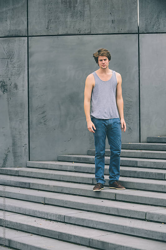 Man on stairway by Urs Siedentop & Co for Stocksy United