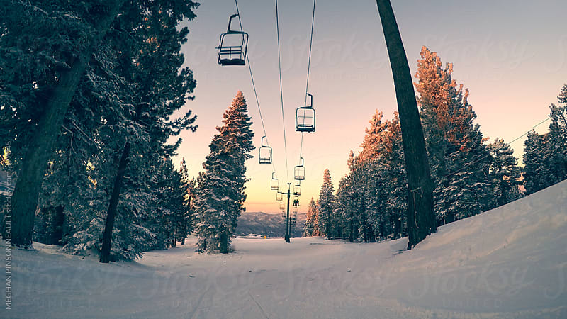 Dreamy Sunset with Chair Lift and Snowy Trees by Meg Pinsonneault for Stocksy United