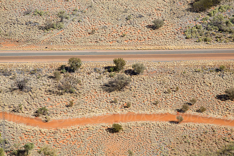 Aerial image of a road and desert path. Australia. by John White for Stocksy United