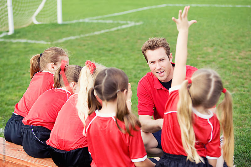 Soccer: Girl Asks Coach a Question by Sean Locke for Stocksy United
