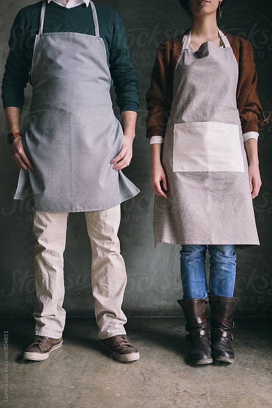 Bakery Employees in Aprons Standing by Lumina for Stocksy United