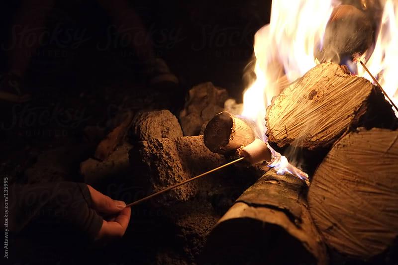 Toasting marshmallows by Jon Attaway for Stocksy United