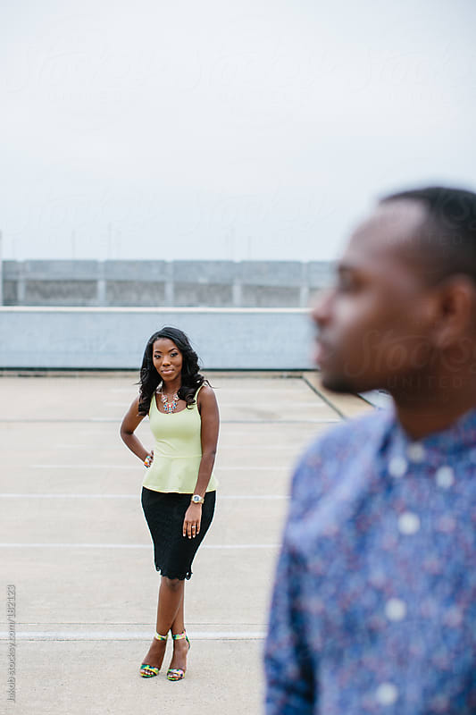 A trendy and fashionable african-american couple on top of a parking garage by Jakob for Stocksy United