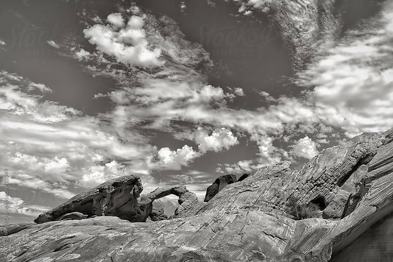 clouds and rocks by ALAN SHAPIRO for Stocksy United