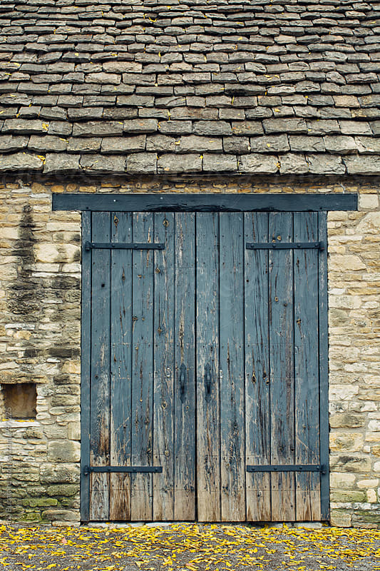 Wooden door on an old English barn by Gabriel (Gabi) Bucataru for Stocksy United