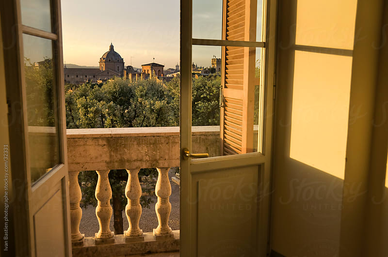 Rome skyline through a window by Ivan Bastien for Stocksy United
