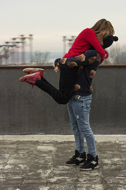 Emotional hug of young couple  by Evil Pixels Photography for Stocksy United