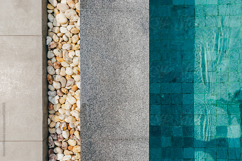 The edge of a swimming pool  by Jovana Milanko for Stocksy United