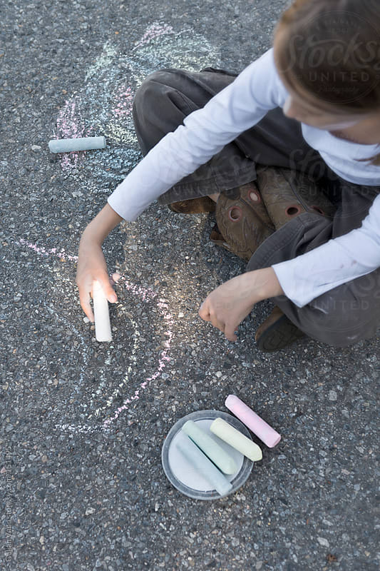 girl with chalk by Gillian Vann for Stocksy United