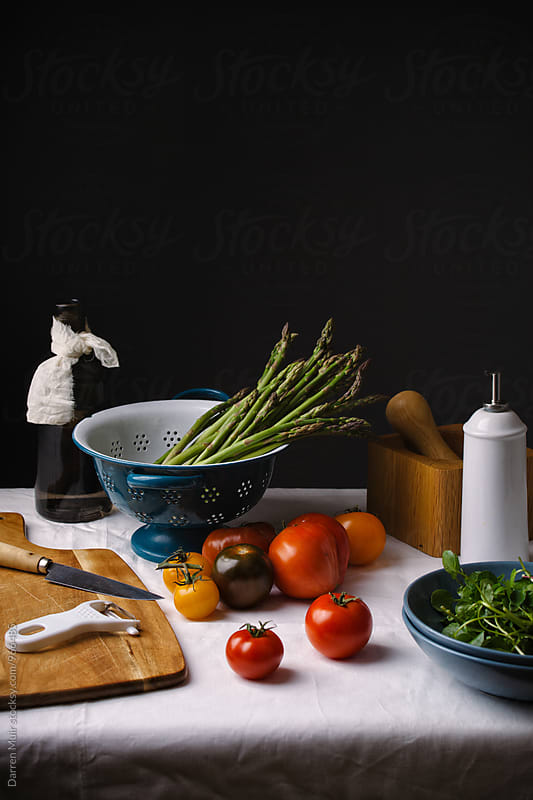 Vegetables on kitchen table ready to be prepared. Lots of copyspace. by Darren Muir for Stocksy United