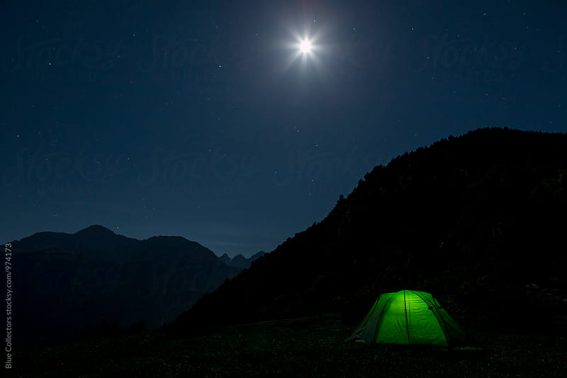 Night camp under the full moon by Jordi Rulló for Stocksy United