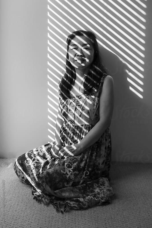 Senior Asian woman portrait in shade by yuko hirao for Stocksy United
