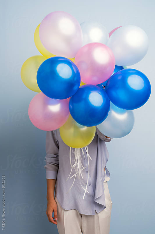 Unrecognizable girl with colorful balloons by Danil Nevsky for Stocksy United