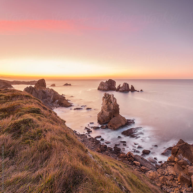 Beautiful rocky coastline at sunset by Marilar Irastorza for Stocksy United