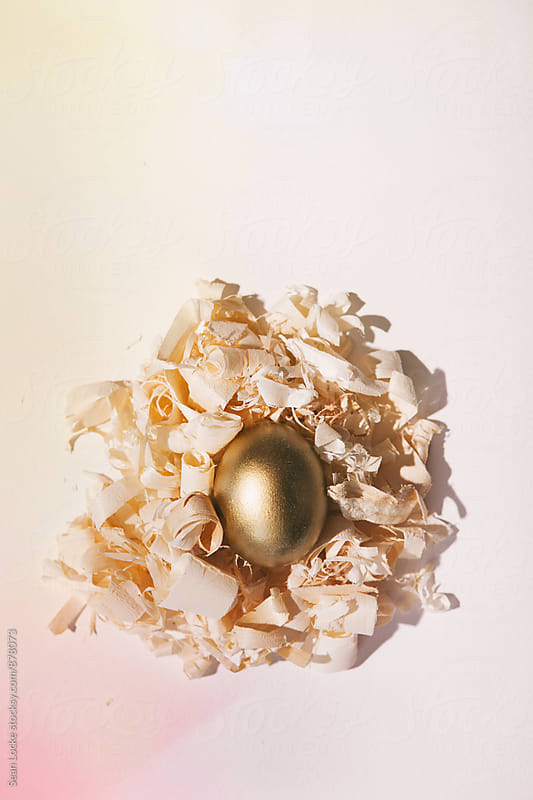 Easter: Colorful Golden Egg In Nest Concept by Sean Locke for Stocksy United