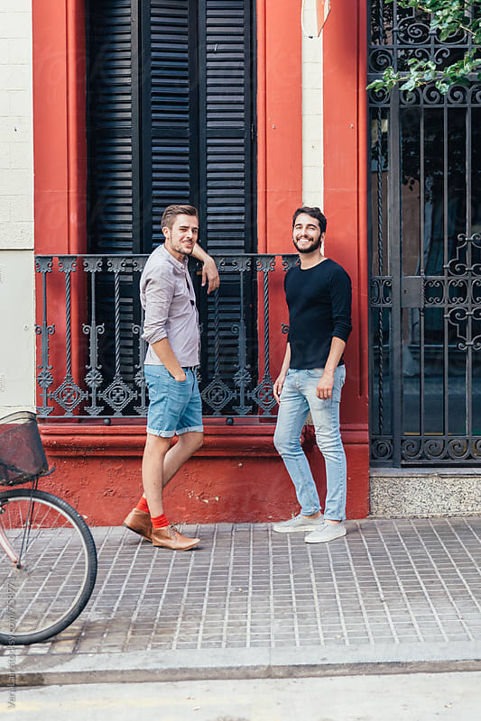 Two friends in the streets of Barcelona by Vera Lair for Stocksy United
