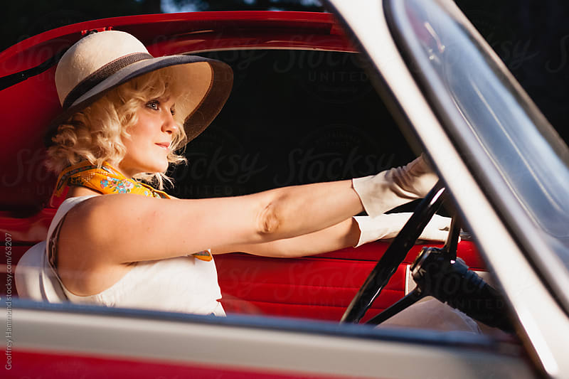 Close -up of Young Woman in Retro Fashion and Car by Geoffrey Hammond for Stocksy United