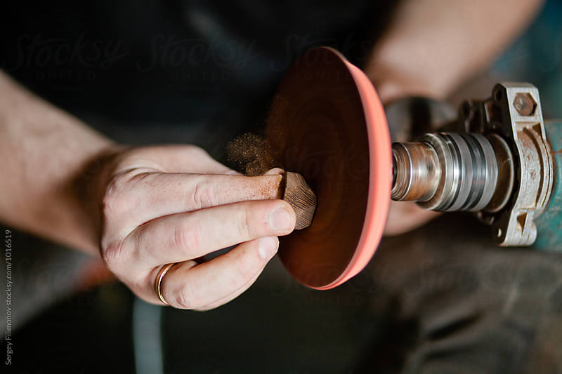 Hands of a man making a ring using a drill by Sergey Filimonov for Stocksy United