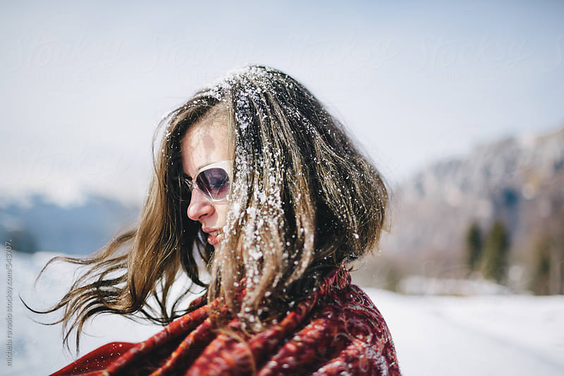 Woman with snow in her hair by michela ravasio for Stocksy United